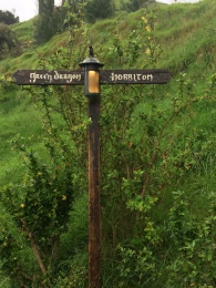 Street sign, Shire-style. One way to the pub, one way to the houses.